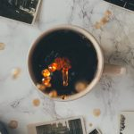 coffee splashing with old pictures all around