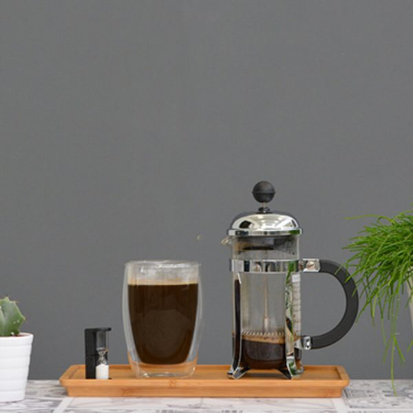 French press with freshly brewed coffee