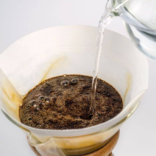 Water being poured in a chemex coffee maker